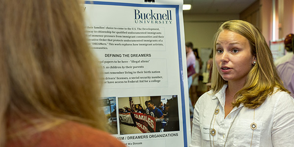 Maggie Carlson '18 discusses her research at a recent poster session.
