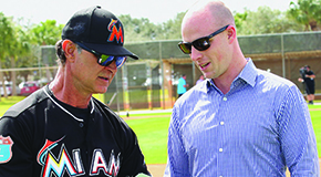 Miami Marlins manager Don Mattingly (left) confers with David Keller '03